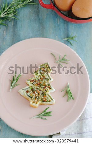 Homemade Christmas Omelette with Herbs on Wooden Background Shape of Christmas Tree