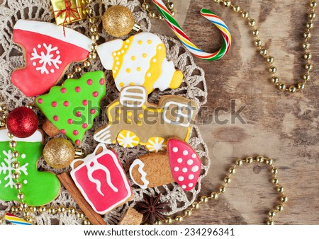 Homemade christmas painted gingerbreads on the wooden background with Christmas decorations. Selective focus and place for text. Toned - stock photo