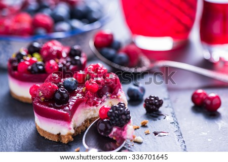 Homemade Christmas winter berry fruit cheesecake on board - stock photo