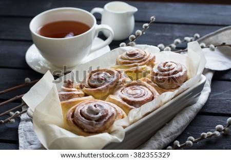 Homemade cinnabons cinnamon rolls with cream cheese glaze - stock photo