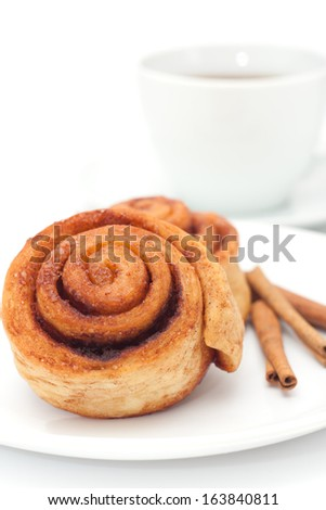 Homemade cinnamon rolls, cup of tea, white background - stock photo