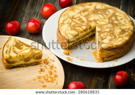 Homemade Coffee marble cheesecake on wooden background