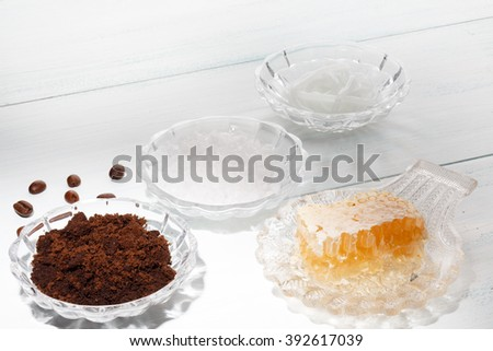 Homemade coffee scrub with cream base, sea salt and honey - stock photo