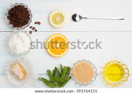 Homemade coffee scrub with lemon, orange, banana, grape-seed oil, honey, yogurt - stock photo