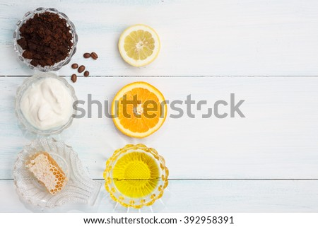 Homemade coffee scrub with lemon, orange, oil, yogurt, honey, top view, flat lay - stock photo