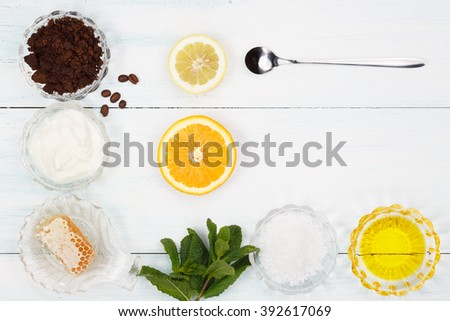 Homemade coffee scrub with lemon, orange, yogurt, mint, grapeseed oil and honey - stock photo