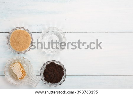 Homemade coffee scrub with sugar, coconut oil, honey - stock photo