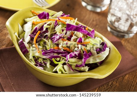 Homemade Coleslaw with Shredded Cabbage, Carrots, and Lettuce - stock photo