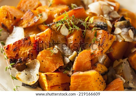 Homemade Cooked Sweet Potato with Onions and Herbs - stock photo