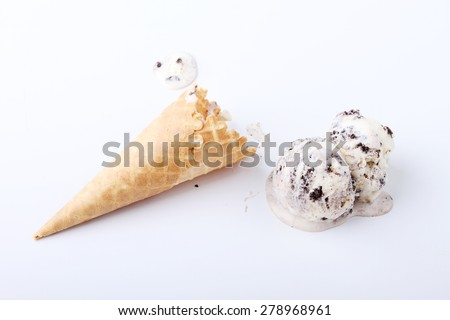 homemade cookie and cream ice cream scoop drop melt on white background - stock photo