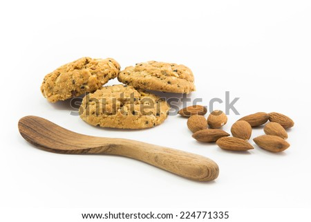 homemade cookie chocolate muesli and almond with wooden spoon. - stock photo