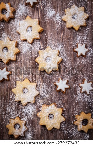 Homemade cookies in star shape not only for Christmas - stock photo