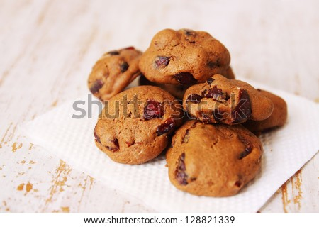 Homemade cookies with cranberries on a wooden board