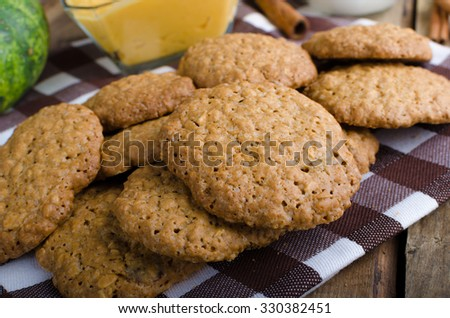 Homemade cookies with pumpkin cinnamon dip, all domestic cookies, whole grain - stock photo