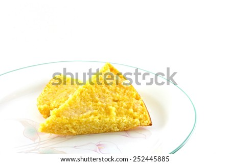 Homemade corn bread on a white background.