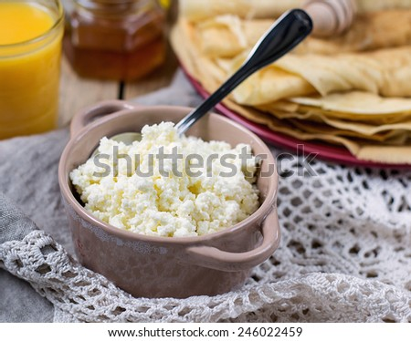 Homemade cottage cheese with orange juice and pancakes for breakfast. Selective focus - stock photo