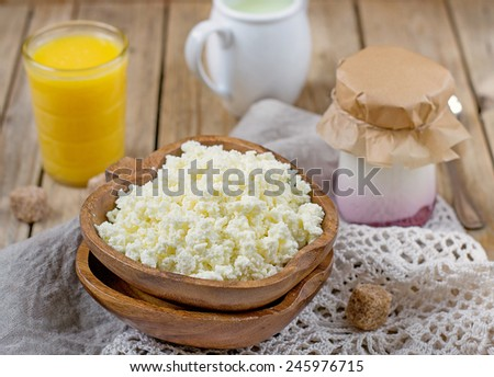 Homemade cottage cheese with orange juice for breakfast. Selective focus - stock photo