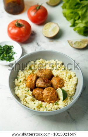 Homemade couscous with meatballs