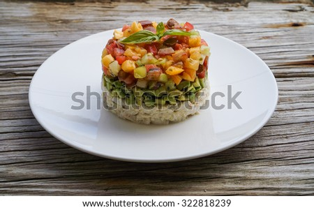 Homemade Crab Meat Salad with Heirloom Tomato Salsa and Sesame Seed Chopped Avocado on Wood Background/ Selective Focus - stock photo