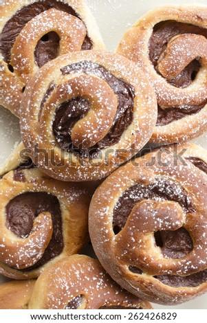 Homemade cream buns with chocolate - stock photo