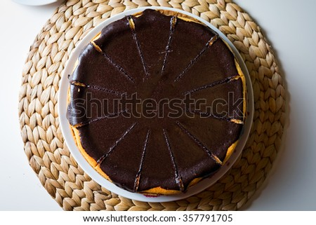 homemade creamy cheesecake topped with chocolate, top view, close up - stock photo