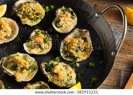 Homemade Creamy Oysters Rockefeller with Cheese and Spinach - stock photo