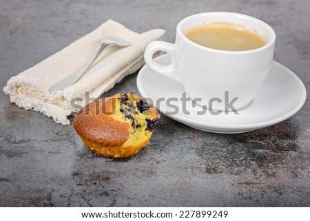 Homemade cupcake and a mug of coffee - stock photo