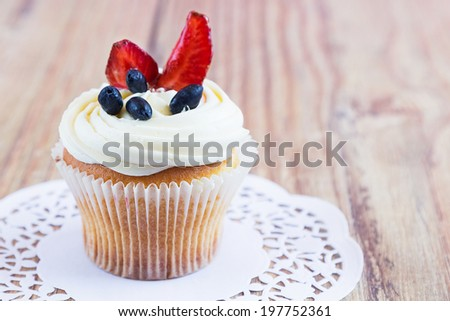 Homemade Cupcake with Berries on wood background, selective focus