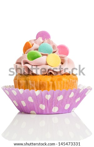 Homemade cupcake with colorful decoration isolated on white background - stock photo