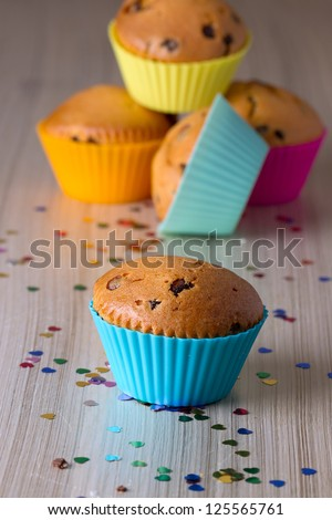 Homemade cupcakes with bright colored silicone molds - stock photo