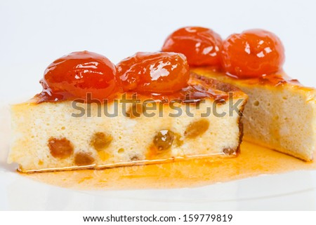 Homemade curd pudding. Dessert cheese cake with apricot jam. Side-view. White background.