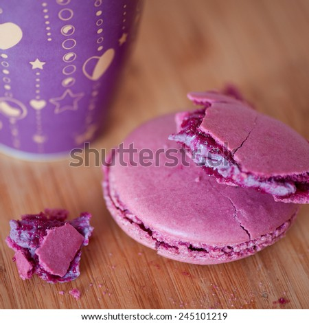 Homemade currant macaroon with cup of black tea staying on wooden table. Selective focus. Romantic morning. Valentines day.  - stock photo