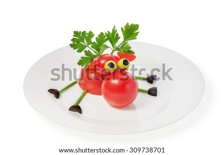 Homemade deer of tomatoes, parsley and olives. The concept of a healthy diet, the raw food diet, lose weight, vegetarian, vegan, slimming. Baby food, funny animals from vegetables. - stock photo