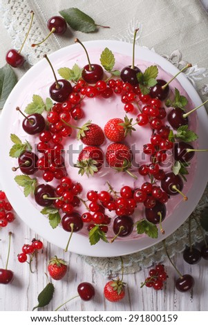 homemade delicious cake with fresh berries on a plate close-up. vertical top view - stock photo
