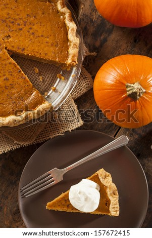 Homemade Delicious Pumpkin Pie made for Thanksgiving - stock photo