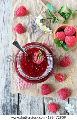 Homemade delicious raspberry jam on a rustic wooden table. Selective focus. - stock photo