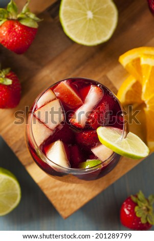 Homemade Delicious Red Sangria with Limes Oranges and Apples - stock photo