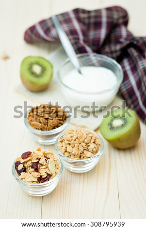 Homemade dessert delicious granola is a breakfast food and snack food consisting of rolled oats, nuts, honey. it is lightweight, high in calories. - stock photo