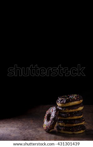 Homemade donuts with sugar and chocolate, rustic dipped