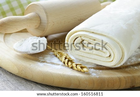 homemade dough  and flour on a wooden board - stock photo