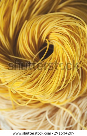 homemade dried chinese noodles roll background - stock photo