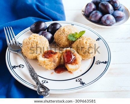 Homemade dumplings with plums served in the plate,selective focus  - stock photo