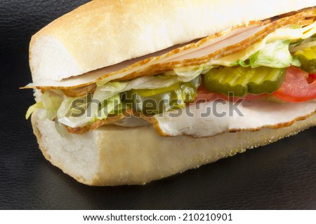 Homemade enormous turkey sub ready to be gobbled up - stock photo