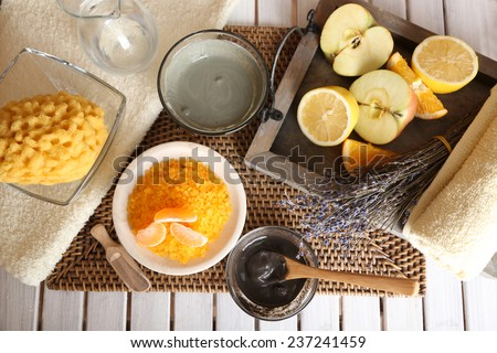 Homemade facial masks with natural ingredients, on color wooden table, on light background - stock photo