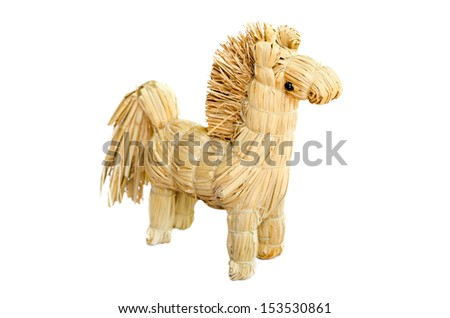 homemade  figurine strawy horse isolated on white background
