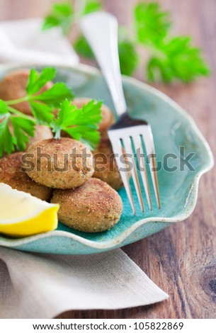 Homemade fish cutlets, selective focus - stock photo