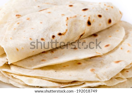 Homemade flour tortillas viewed close-up. - stock photo