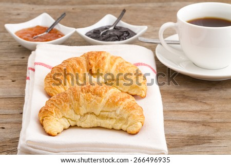 Homemade French croissants on a wooden background