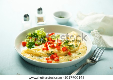Homemade French omelette with capsicum and herbs