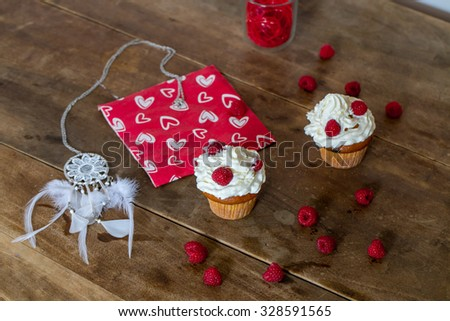 Homemade fresh baked muffins with raspberries on old rustic wooden background, delicious dessert. Selective focus